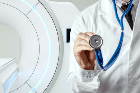 Doctor on the background of the MRI machine, medical concept. Modern technologies, the future of medicine, scientific research