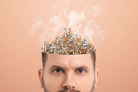 Rubbish in the head, a man's head is open instead of a brain butts, the head is an ashtray. Creative background, unnecessary information, useless knowledge, wrong thinking