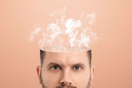 The boiling point, the male head is open, instead of the brain, there is steam or smoke, processing. Creative background, fatigue, nervousness, stress