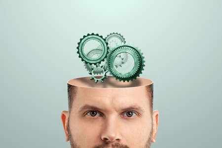 Close-up of a male head instead of a brain with gears, Brain function concept, mind psychology, thinking. Creative background 스톡 콘텐츠