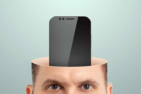 Smartphone addiction, close-up of a man's head instead of a mobile phone brain. Technology concept, human weakness, addiction. Creative background