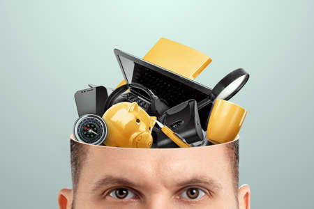 Rubbish in the head, a man's head is open instead of a brain, various office rubbish. Creative background, unnecessary information, useless knowledge, wrong thinking 스톡 콘텐츠