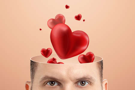 Falling in love, close-up of a man's head instead of a brain of hearts. Family, love, relationship concept. Creative background