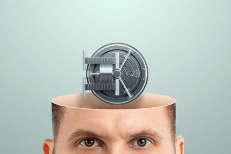 Close-up of a man's head instead of a brain on the bank vault door. Concept for good memory, strong password, data encryption, intellectual property protection. Creative background