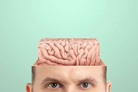 The concept of non-standard thinking and creativity., The male head is open from which the square brain is visible. Creative background, brain, fantasy, genius, creativity, not what it seems