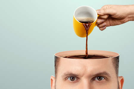 The man's head is open and coffee is poured into it from a cup. Creative background, coffee lover, brain drug, caffeine