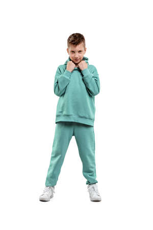 boy in a turquoise suit and white sneakers isolated on a white background