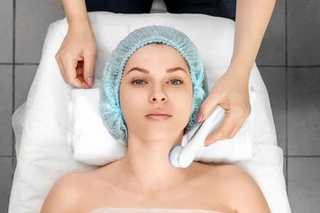 Medical, cosmetological procedure for the treatment of facial skin with light, phototherapy for cleansing the pores on the face. Skin care, cosmetic procedures