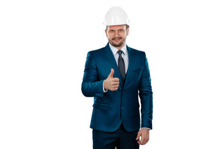 A man in a business suit, an architect with a white helmet on his head, isolated on a white background. Architecture, construction concept