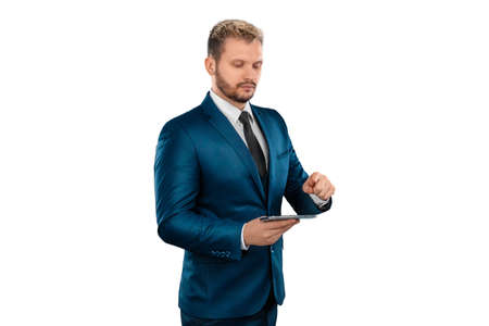 Man, Businessman in a business suit holds a smartphone in his hands is isolated on a white background. Uses the Internet for work and communication. concept Business online, remote work, freelance