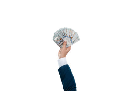 Man's hand in a business suit holds 100 dollar bills, money in hand isolated on white background. Business concept, investment, loan, salary Standard-Bild