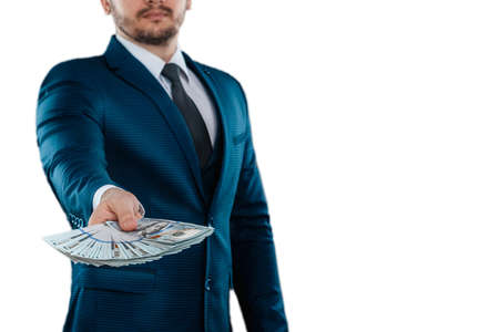 Man, businessman in a business suit holds dollars in his hands isolated on a white background. The concept of success, loan, investment, collateral, salary
