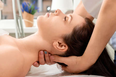 A beautiful girl is doing a neck massage. Skin care, beautician, spa treatments, relaxation