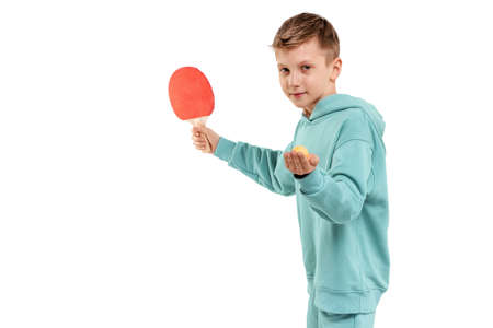 Handsome boy in burgundy suit plays table tennis isolated on white background. Sports concept, masterclass, table tennis. Isolate, copy space 免版税图像
