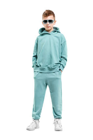 boy in turquoise blue tracksuit isolated on white background