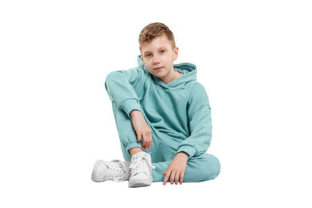Handsome boy in blue suit isolated on white background. Studio portrait of a child Stock fotó