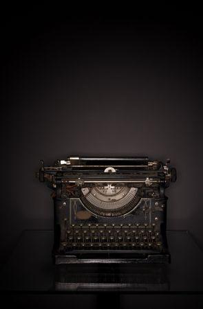 lowkey: 1920s typewriter, low-key ringflash shot.