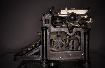 lowkey: 1920s typewriter, low-key ringflash shot (side view).