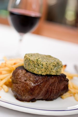 caf: Steak with herbed butter (Caf� de Paris style) with french fries and gravy