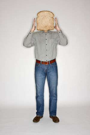 merged: Man with a slice of bread in place of his head Stock Photo