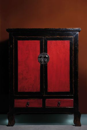 furniture detail: Vintage Chinese cabinet, lacquered red and black wood