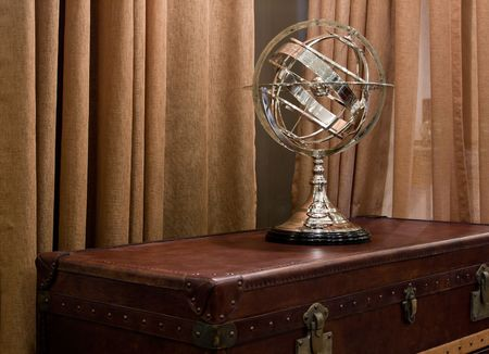 superstitions: Astrology celestial sphere on a vintage leather upholstery chest