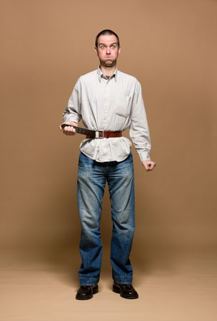 austere: Young man with a belt tightened to the extreme