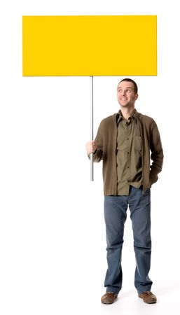 to observer: Casual young man holding a placard  sign, looking up at the sign Stock Photo