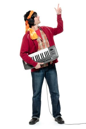 Young man holding musical keyboard, wearing headphones, pointing up photo