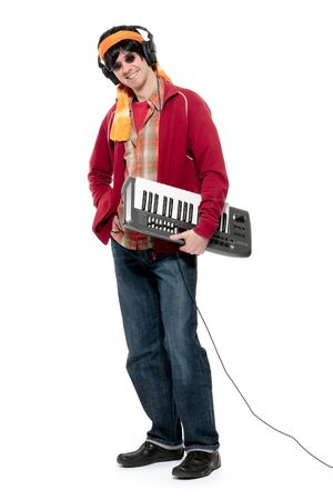 Casual young man holding an electronic musical keyboard photo