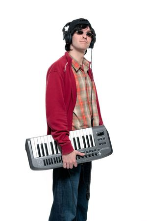 Young man holding musical keyboard, wearing headphones, looking up photo