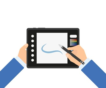 designer graphics tablet with a stylus in hand