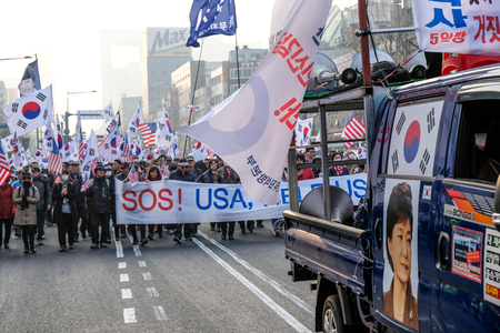 Seoul March 24th. People manifest against actual government in South Korea. Against president Moon Jae-in and his politics for unification of Korean peninsula. Asking USA help, asking Trump help.