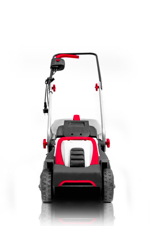 New lawn mower isolated on a white background photo
