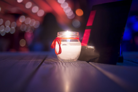 atmosphere: Romantic atmosphere with a candle on the table Stock Photo