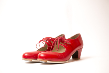 Red tango shoes on a white background