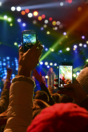 People holding their smartphones and photographing concert Stock Photo