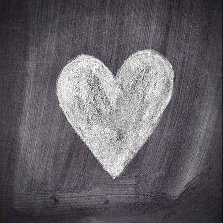 Heart shape chalk drawing on chalkboard blackboard photo