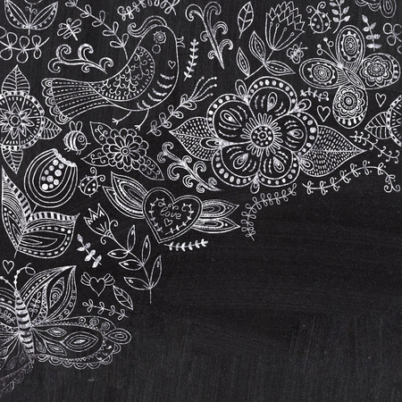 lace like: Chalk floral corner on chalkboard blackboard. Ornamental round lace pattern, circle background with many details, looks like crocheting handmade lace on grunge background, lacy arabesque designs. Stock Photo