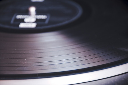 record player: Segment of vinyl record with label showing the texture of the grooves, retro look , with copyspace Stock Photo