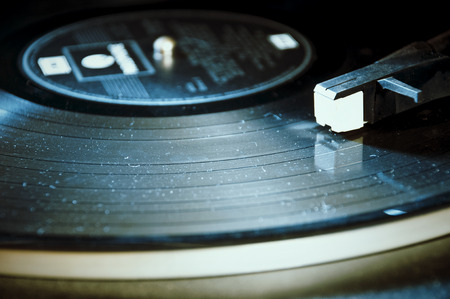 grooves: Segment of vinyl record with label showing the texture of the grooves, retro look , with copyspace Stock Photo
