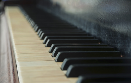 old piano: Closeup of old piano keyboard Stock Photo