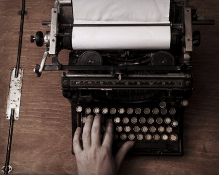 detective agency: Typing on the vintage typewriter Stock Photo