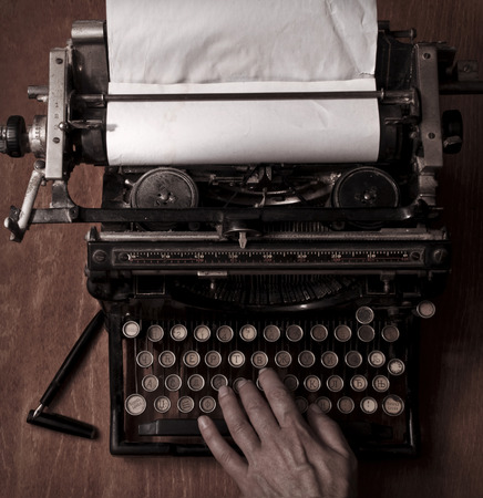 bureaucrat: Typing on the vintage typewriter Stock Photo