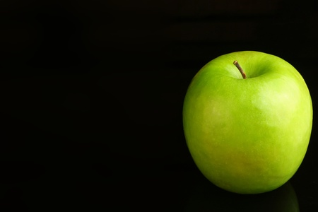 granny smith: Granny Smith apple on a black background.