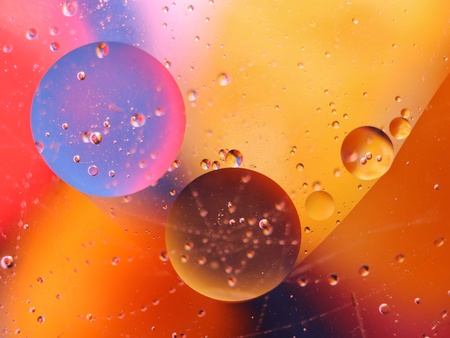 abstract colorful backdrop with oil drops on water surface. possible themes for the application - cosmetic advertising, space, fantasy.