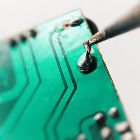 soldering contact on a printed circuit board, isolated image on a white background, macro shooting.