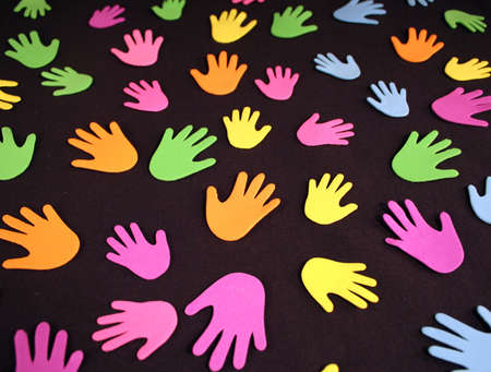 A group of pastel colored hands