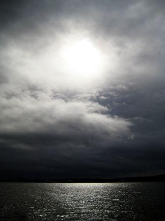 puget: Eye of Light Over Puget Sound Stock Photo