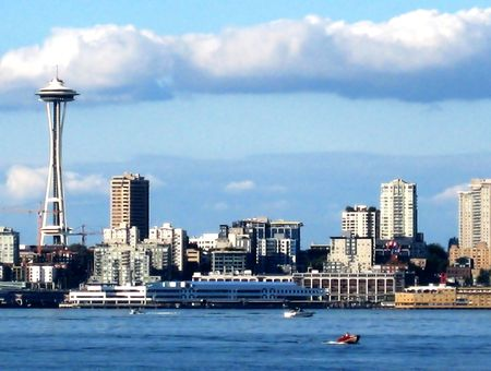 Seattle Skyline with Space Needle with the surrounding buildings in its vicinity as well as the coastline.